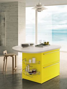Contemporary kitchen island, Snaidero SKYLINE 2.0 features yellow lemon high-gloss lacquered cabinet doors with ergonomic handles #SnaideroUSA | Lucci Orlandini Design