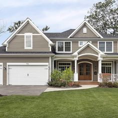 james hardie timber bark siding | Shingle style home with gracious front porch entry.