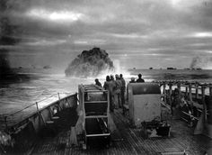 A depth charge explodes behind a US convoy crossing the Atlantic in April 1943, critically damaging the German submarine U-175.