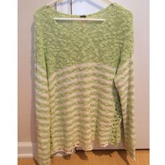 Free People Striped Sweater Super soft and comfy striped Free People sweater, funky cutout design on the bilateral sides toward the bottom. Only sign of wear is the discoloration near the tag as seen in the third pic Free People Sweaters