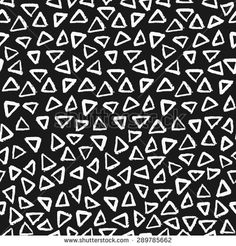 Hand painted triangle shapes in white on black background. Seamless abstract repeating hand drawn background. - stock vector