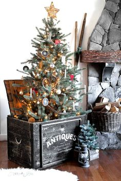 Christmas tree in an Antiques crate - frame out and stencil a plain lidded crate to create a one-of-a-kind tree stand! With Antiques stencil from Funky Junk's Old Sign Stencils and Fusion Mineral Paint. Tutorial at funkyjunkinterior. Noel Christmas, Rustic Christmas, Winter Christmas, Vintage Christmas, Christmas Wreaths, Christmas Crafts, Primitive Christmas Tree, Farmhouse Christmas Tree Stands, Ikea Christmas Tree