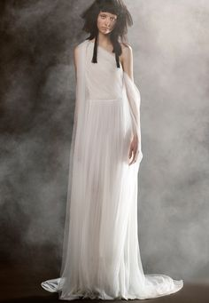 SABINE is a soft white silk crepe off the shoulder cowl neck wedding gown with French tulle draped sleeves by Vera Wang.