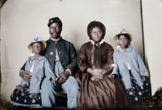 Sergeant Samuel Smith of the 119th US Colored Infantry, his wife Molle and their daughters Mary and Maggie. c. 1865 - Photo restoration by Redditor kibblenbits.
