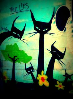 Street art. unknown artist. scratchy cats. True Lies graffiti.