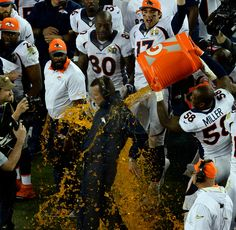 . Von Miller (58) of the Denver Broncos dumps Gatorade on head coach Gary Kubiak of the Denver Broncos late in the fourth quarter. The Broncos defeated the Panthers 24 to 10 in Super Bowl 50. The Denver Broncos played the Carolina Panthers in Super Bowl 50 at Levi\'s Stadium in Santa Clara, Calif. on February 7, 2016. (Photo by Helen H. Richardson/The Denver Post)