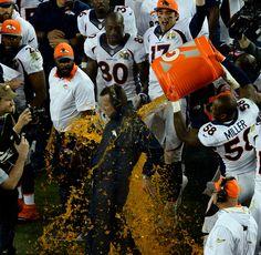 . Von Miller (58) of the Denver Broncos dumps Gatorade on head coach Gary Kubiak…
