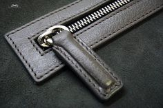 Leather zip collar with a puller attached on the inside of the bag
