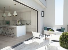 Contemporary kitchen with open design and outdoor lighting by Green Couch
