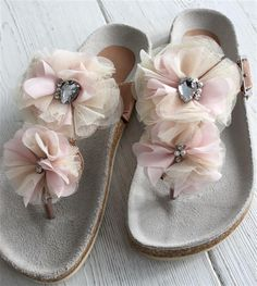Perhaps create fabric flowers, apply rhinestones, then sew on to a security pin = removable flip flop/sandal decoration! The possibilities!