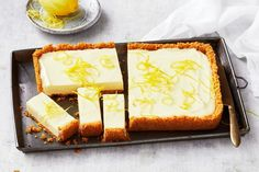 This no-bake lemon slice features a thick biscuit crust and cheesecake-style filling made from cream cheese and sweetened condensed milk. It'll be your new favourite dessert! No Bake Lemon Slice, No Bake Slices, Lemon Desserts, Easy Desserts, Dessert Recipes, Lemon Recipes, Sweet Recipes, Tart Recipes, Mini Desserts