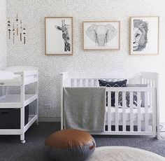 Take the wallpaper and pictures off the wall and remove the unnecessary pouf, and this nursery is perfect! Incredibly simple and tasteful, and also gender-neutral. Clean and crisp, your baby will fresh any and every time they are in this room!