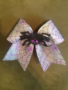 Spider cheer bow purple black Halloween bow by BoiseBows on Etsy https://www.etsy.com/listing/204154861/spider-cheer-bow-purple-black-halloween