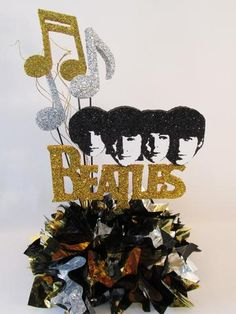 Beatles themed centerpiece with Faces of John, Paul, George & Ringo cutout on metallic tissue base with musical notes centerpiece great for any Beatles party Disco Party Decorations, Fun Party Themes, Birthday Decorations, Birthday Ideas, Party Ideas, Theme Parties, 80th Birthday, Beatles Birthday, Beatles Party