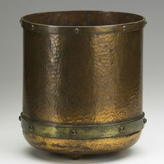 ROYCROFT  Three-footed jardiniere, East Aurora, NY, ca. 1915  Hammered copper, brass
