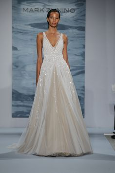 White beaded net over nude deep V-necked gown with illusion ball skirt