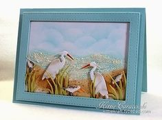 handcrafted card: KC Impression Obsession Shore Birds 3 ... great beach scene ... die cut egrets/herons and shore birds ... luv the frame die cut and the frothy waves created with Liquid Applique ... beautiful work of art!