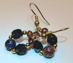 Metal flower and crystal beaded dangle earrings with gold.  on Etsy, $13.00