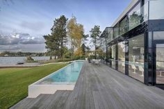 BBSC Architects designed this house at a lake in Belgium.