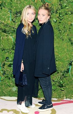 Mary-Kate and Ashley Olsen stick to the basics of black and navy with matching casual sneakers