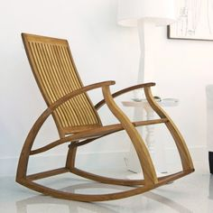Love this modern rocking chair - I'd put four on our porch, painted gray or white. Unless they're teak, in which case, they'd fade to the perfect color.