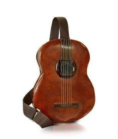 Instrumental Baggage - Pratesi's Guitar Backpack is a calf leather masterpiece for music lovers. This acoustic traveling companion is vegetable-dyed and has a nift. Unique Bags, Woodland Creatures, Visual Kei, Baggage, Purses And Bags, Lv Bags, Cool Stuff, Stuff To Buy, Harajuku