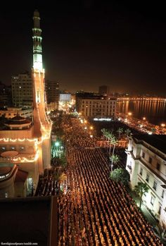Thousands of Egyptian Muslims perform evening prayers called Tahajjud; during Laylat al-Qadr in the holy month of Ramadan at Al-Qaed Ibrahim Mosque in the Mediterranean city of Alexandria, on August 27, 2011. Laylat al-Qadr, or Night of Decree, is the night the Quran was revealed to Prophet Muhammad saw by the angel Jibreel. (REUTERS/Amr Abdallah Dalsh)
