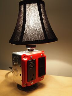 Table or desk lamp & USB charging station (Iphone, blackberry, tablets). $96.00, via Etsy.
