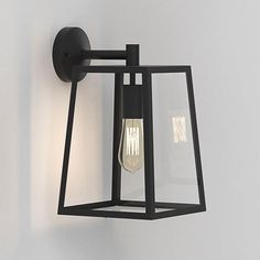190€ |  The Calvi 305 exterior wall light by Astro is finished in Textured Black. This light has a contemporary lantern look and looks beautiful with a vintage filament lamp installed. This fitting can be dimmed if a dimmable lamp is used. Class 1, earthed and IP23 rated.