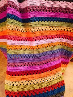 http://www.ravelry.com/projects/neeneemac/cosy-stripe-blanket