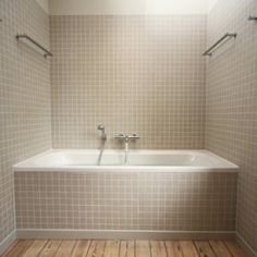 Drop-in tiled tub. Ignore the style just the concept