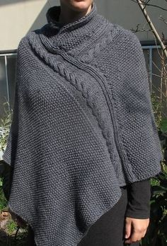 Free Knitting Pattern for Alexis Poncho - Quick poncho knit in 2 rectangles knit in seed stitch, cable, and ribbing. Collar is knit separately and sewn on. Worsted weight yarn. Designed by Sisters in Wool. Available in English and French