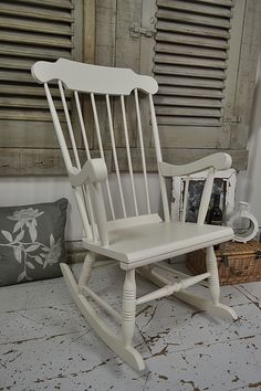 This shabby chic pine rocking chair painted in Farrow & Ball Slipper Satin is lightly distressed - just perfect for relaxing and will add charm to any room! http://www.thetreasuretrove.co.uk/seating/white-shabby-chic-spindleback-rocking-chair
