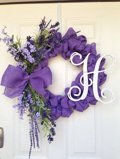Spring Burlap Wreath - purple burlap ribbon, bow with purple flowers and monogram letter - love it!Spring Purple Burlap Wreath Chelsea Wiles tell Lisa I want her to make me this! So pretty for spring/summerspring floral organza wreath how to make dec Deco Mesh Wreaths, Door Wreaths, Burlap Wreaths, Floral Wreaths, Burlap Ribbon, Ribbon Wreaths, Yarn Wreaths, Ribbon Bows, Wreath Crafts