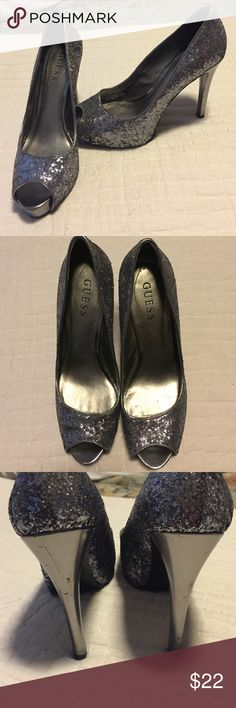 """Silver glitter Guess heels Silver glitter heels with platform. Worn about 5 times so has some scratches on heel (shown in pic) but not noticeable when wearing really. Glitter is in excellent condition!!! Inside has signs of wear. Very comfy! 4 1/2"""" heel. 1"""" platform. GUESS Shoes Heels"""