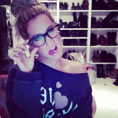 Glam Squads, a Surprise Engagement, and More of the Weeks Cute Celebrity Candids: Ashley Tisdale showed off her new glasses and said that she felt smarter already.Source: Instagram user ashleytis