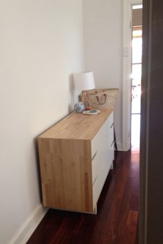 Dulux natural white, with ikea chest of drawers as kitchen side board, jarrah floors
