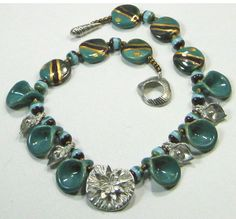 Finalist Entry by Virginia Patton. Virginia used the Dorabeth Design Water Lily Pad Pendant Dorabeth Small Shell Toggle along with Kazuri Beads to make this beautiful necklace.