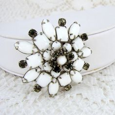 Hey, I found this really awesome Etsy listing at https://www.etsy.com/listing/29876443/vintage-milk-glass-brooch-gray