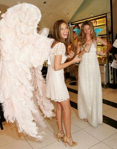 Adriana Lima and Gisele Bundchen unveil 'Dream Angels Heavenly' fragrance wearing self designed wings at Victoria's Secret Herald Square May 10, 2006 in New York City.