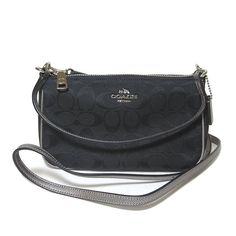 Coach Signature Top Handle Cross Body Silver, black, metallic color. Mini cross body. New with tags. Still have glitter box it comes with. Lost my receipt and I found a bag that suits me better * why I'm selling. Open to reasonable offers. More pictures soon. Coach Bags Crossbody Bags