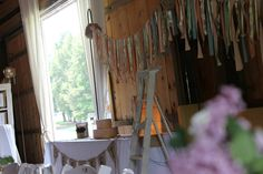 (pre-renovation) Barn wedding long tables decorated by Elizabeth Blair & Co.
