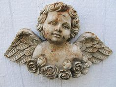 Cherub with roses and wings