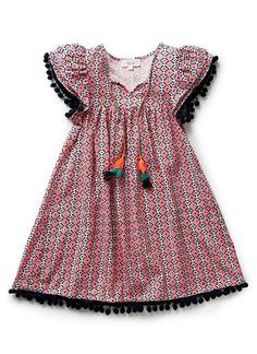 100% Viscose Dress. Folk print dress with yoke, and ruffled sleeve. A-line silhouette. Features pom-pom trim on sleeve and hem. Also features rope ties on neckline. Available in colour shown.