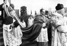 Cardinal Pacelli in procession wearing the cappa magna.