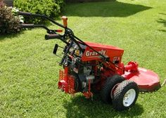 12 horse Gravely walk behind. I use the hell out of one similar to this. Just like having a full sized tractor except no seat. Walk Behind Tractor, Tractor Pulling, Lawn Maintenance, Hardy Plants, Small Engine, Mower Parts, Planting Seeds, Lawn Mower, Outdoor Power Equipment