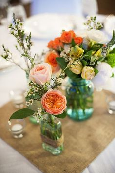 A variety of flowers in random jars - I did this for my rustic wedding and I still get compliments years later.