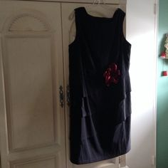 Sleeveless black formal dress Black sleeveless formal dress with red rose embellishment. Waist down tiered skirt. Beautiful dress to wear to a wedding! Dress Barn Dresses