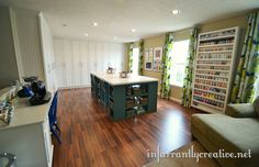 Like the wall of cabinets.   Now this is a craft room from Infarrantly Creative!