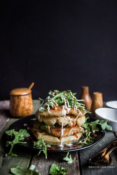 Panko Chicken and Waffles. Pan-fried panko crusted chicken piled on top of thick and fluffy waffles with some peppery arugula and drizzle of kewpie mayo and sriracha sauce is just out of this world